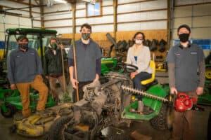 Nikki Wegner poses with Chinook's Grounds Maintenance Crew